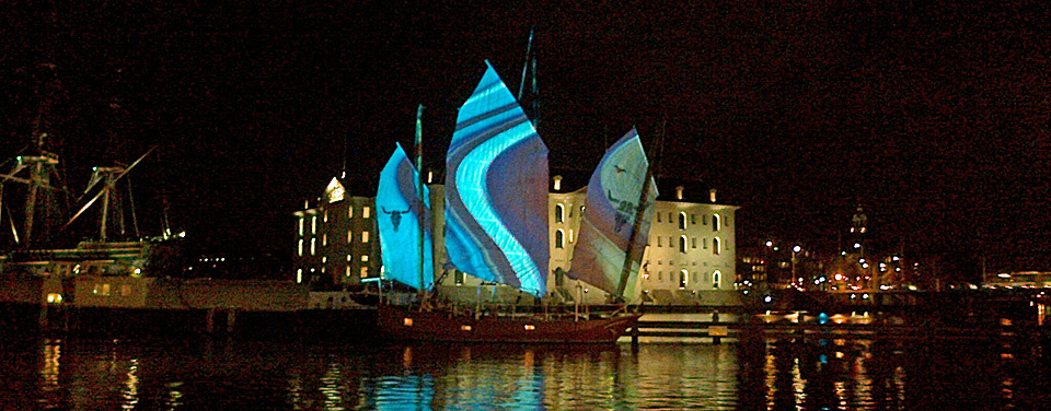 Coloured lights on sails at Amsterdam Light Festival 2013 near Amsterdam Maritime Museum