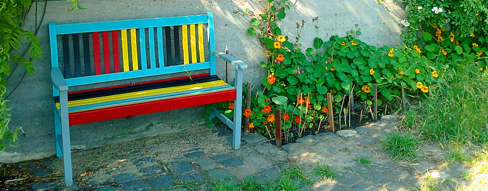 pavement garden in Amsterdam with coloured seat